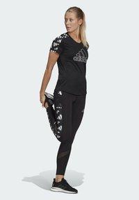 adidas Performance - OWN THE RUN CELEBRATION T-SHIRT - Print T-shirt - black - 1