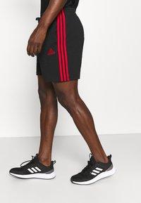 adidas Performance - Krótkie spodenki sportowe - black/scarlet - 2