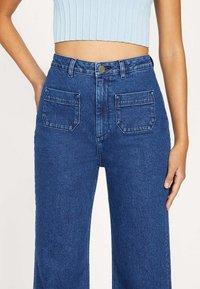 Kookai - ROMANTIQUE - Flared Jeans - yn-brut - 2