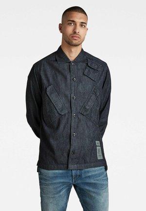 MULTI SLANT POCKET DENIM RELAXED - Giacca di jeans - rinsed