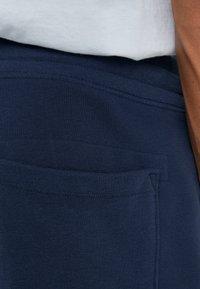 True Religion - SHORT LOGO PUFFY - Tracksuit bottoms - dark blue - 3