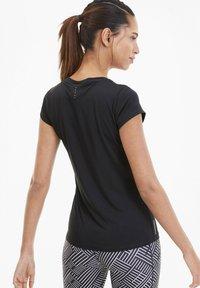 Puma - LAST LAP GRAPHIC - T-shirt de sport - black - 2