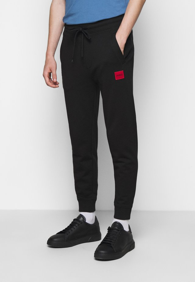 DOAK - Pantaloni sportivi - black