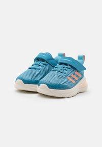 adidas Performance - FORTARUN UNISEX - Obuwie do biegania treningowe - hazy blue/glow pink/hazy sky - 1