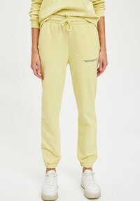 DeFacto Fit - Tracksuit bottoms - yellow - 0
