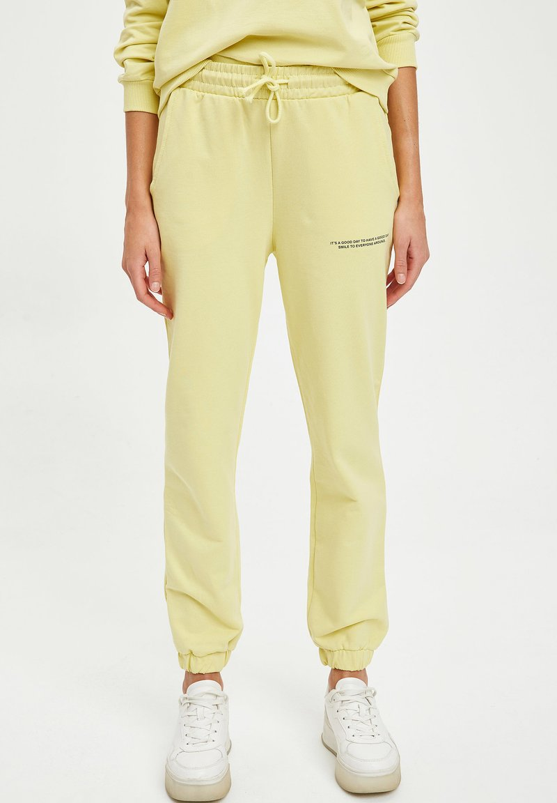 DeFacto Fit - Tracksuit bottoms - yellow