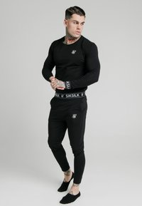 SIKSILK - LOUNGE PANTS - Tracksuit bottoms - black - 1