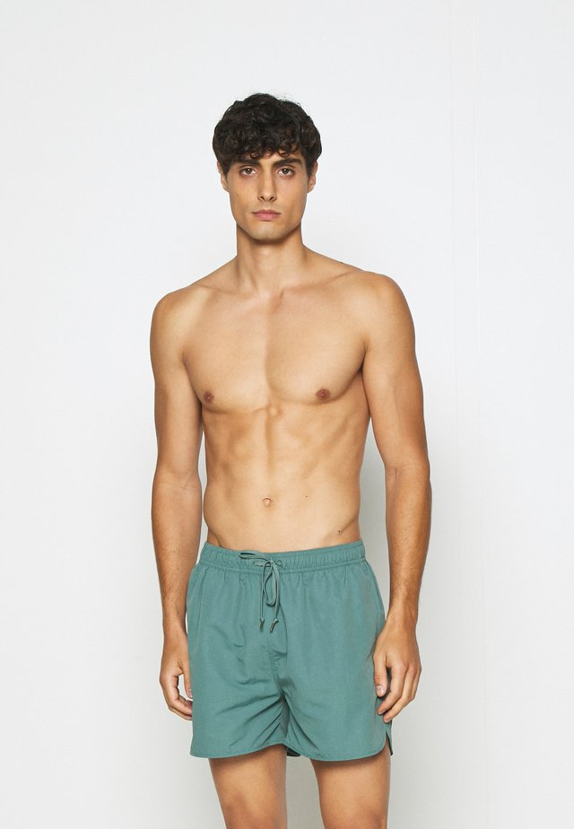 SWIMMING SHORTS - Swimming shorts - green medium dusty