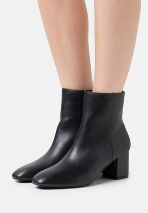 KLARA - Classic ankle boots - black