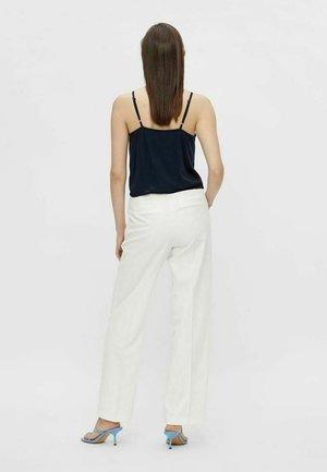 YASWIRA - Trousers - eggnog