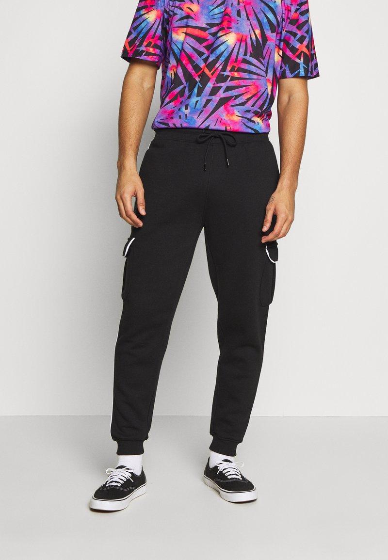 Urban Threads - Pantalones deportivos - black