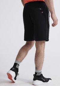 Superdry - Sports shorts - black - 2