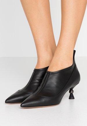 ALEX - Classic ankle boots - black