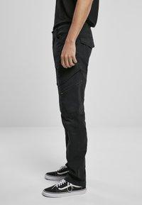 Brandit - ACCESSOIRES ADVEN  - Cargo trousers - black - 3