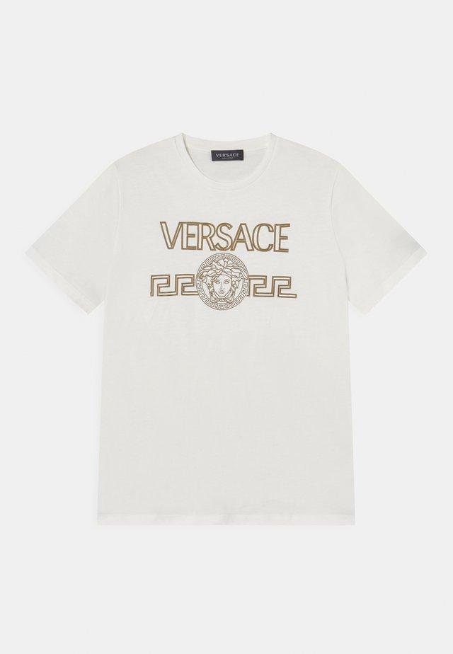 T-shirt con stampa - bianco/oro