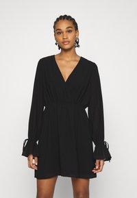 NA-KD - STRAP TIE MINI DRESS - Day dress - black - 0