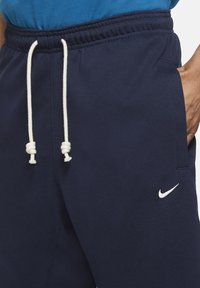Nike Performance - DF STD ISSUE - Tracksuit bottoms - college navy/pale ivory - 3