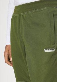 adidas Originals - UNISEX - Tracksuit bottoms - wild pine - 3