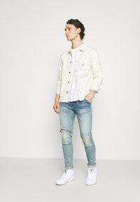 G-Star - 5620 3D ZIP KNEE SKINNY - Jeans Skinny Fit - vintage cool aqua destroyed - 1