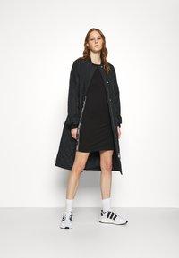 Tommy Jeans - TAPE DETAIL LONGSLEEVE DRESS - Sukienka z dżerseju - black - 1