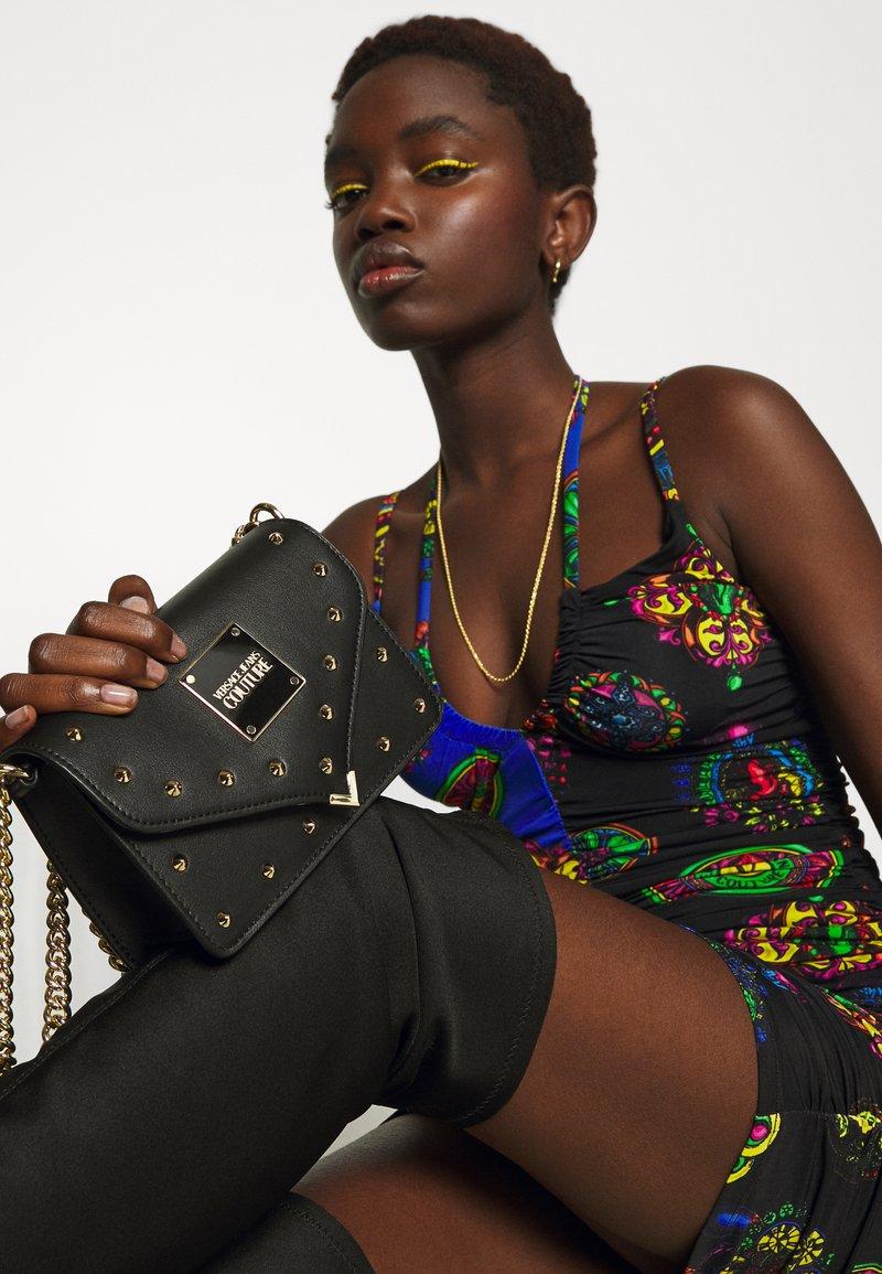 Versace Jeans Couture - REVOLUTION STUDS CROSSBODY - Across body bag - nero