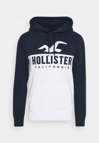 Hollister Co. - TECH LOGO SPLICE - Jersey con capucha - white/navy - 0