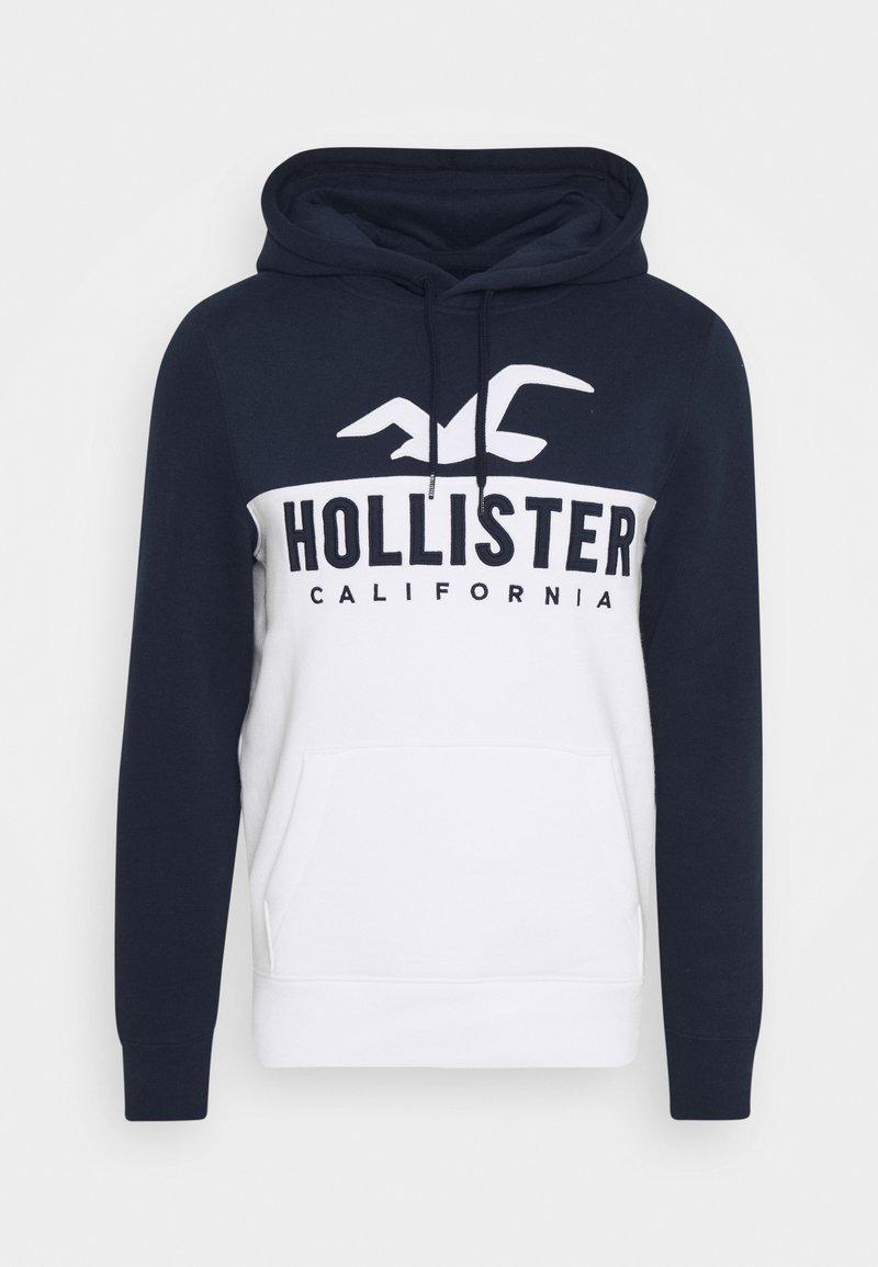 Hollister Co. - TECH LOGO SPLICE - Jersey con capucha - white/navy