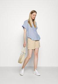 Marks & Spencer London - BLOUSE - T-shirt med print - blue - 1