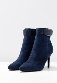 Calvin Klein - GITAR - High heeled ankle boots - dark navy - 4