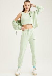 DeFacto - Zip-up hoodie - turquoise - 1