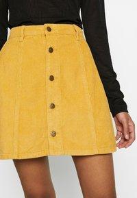 MINKPINK - LAPS AROUND THE SUN MINI SKIRT - A-line skirt - golden yellow - 5