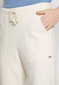 TOM TAILOR DENIM - Tracksuit bottoms - soft creme beige - 6