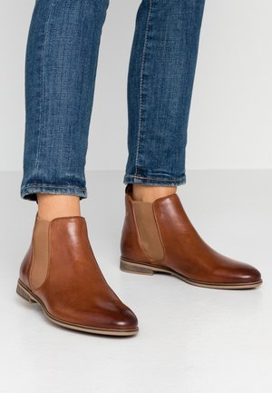 LEATHER BOOTIES - Ankle boots - cognac