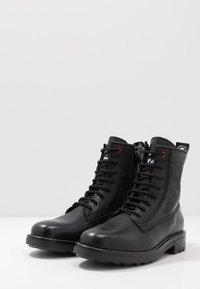 Diesel - D-THROUPER DBB Z - Lace-up ankle boots - black - 2
