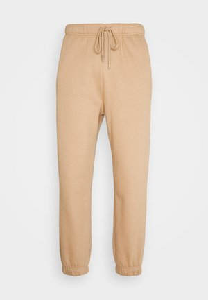 FREEDOM PANTS - Tracksuit bottoms - beige