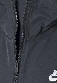 Nike Sportswear - ANORAK  - Windbreaker - black - 8
