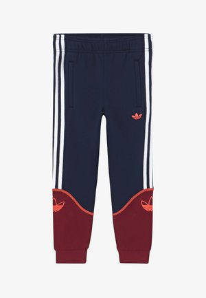OUTLINE PANTS - Tracksuit bottoms - dark blue