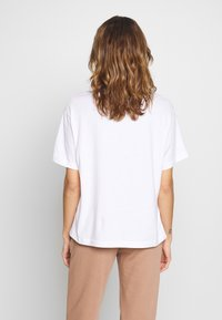 Nike Sportswear - T-Shirt basic - white/black - 2