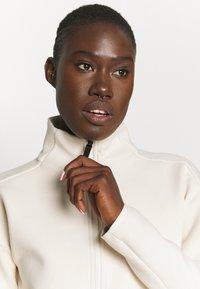 adidas Performance - ZNE MOTHER - Zip-up sweatshirt - white - 3