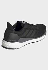 adidas Performance - SOLARBOOST 19 SHOES - Stabilty running shoes - black - 4