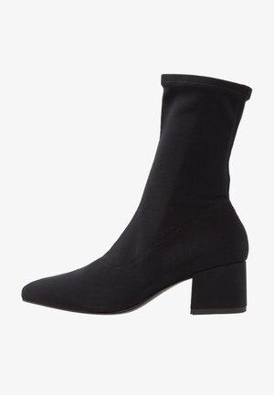 MYA - Classic ankle boots - black