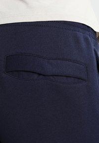 Nike Sportswear - CLUB JOGGER - Tracksuit bottoms - blue - 4