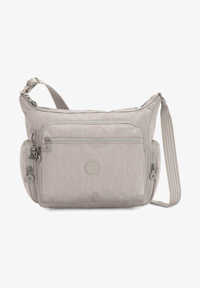 GABBIE - Across body bag - grey/beige