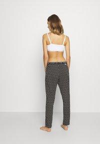Calvin Klein Underwear - LOUNGE SLEEP PANT - Pyjama bottoms - black - 2
