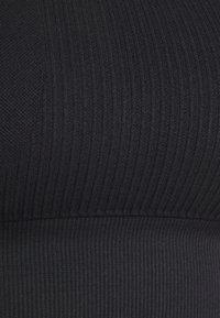 Smilodox - SEAMLESS BRA  - Light support sports bra - schwarz - 2