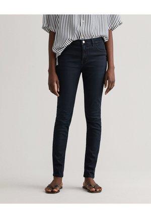 NELLA - Slim fit jeans - black worn in