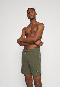 Jack & Jones - JJIFIJI JJSWIMSHORTS SOLID - Swimming shorts - dusty olive - 0