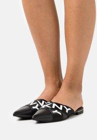 DKNY - ALYA FLAT MULE - Mules - black/white - 0