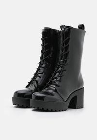 Monki - Platform ankle boots - black - 2