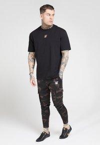SIKSILK - ATHLETE PANTS - Teplákové kalhoty - dark - 1